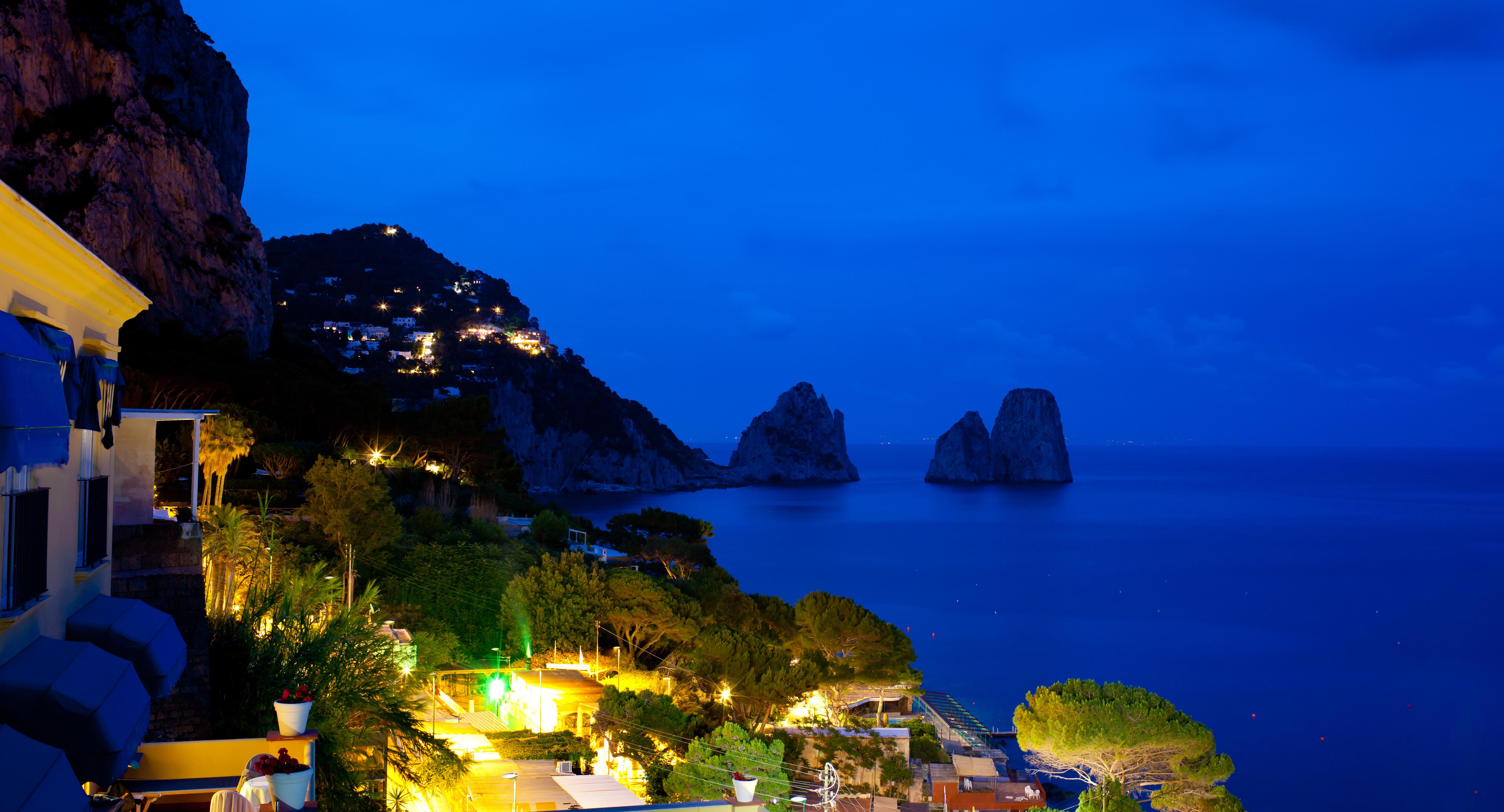 View of Marina Piccola and Faraglioni by night, Capri island